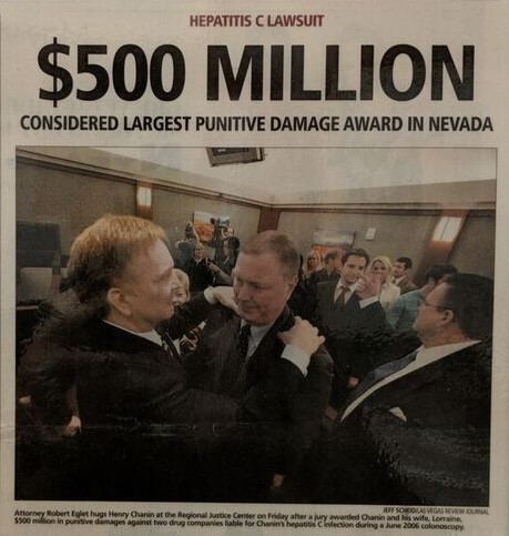 Robert Eglet hugs Henry Chanin after jury awards 500 million in damages