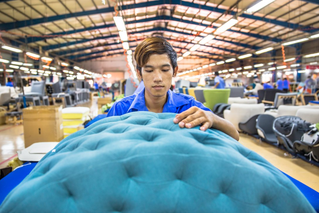Factory Ho Chi Minh City Photographer Ehrin Macksey produces Corporate, Industrial photography for furniture Manufacture. Photography by Ehrin Macksey.