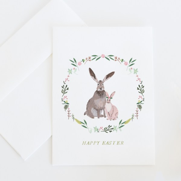 Happy Easter Bunny || A whimsical Easter greeting card illustrated with Easter rabbits surrounded by a spring floral wreath. >> Eight Pepperberries Paperie