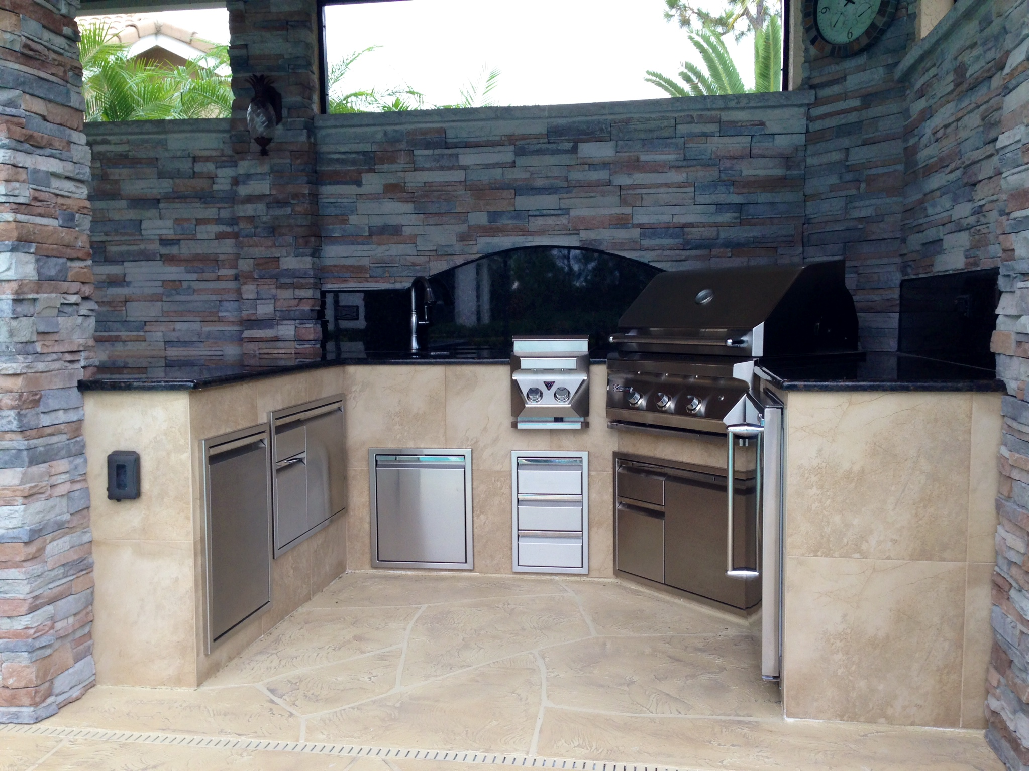 stacked stone outdoor kitchen ceiling fans with bright lights  landscape design ideas