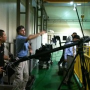 Andy Linda directing in a factory