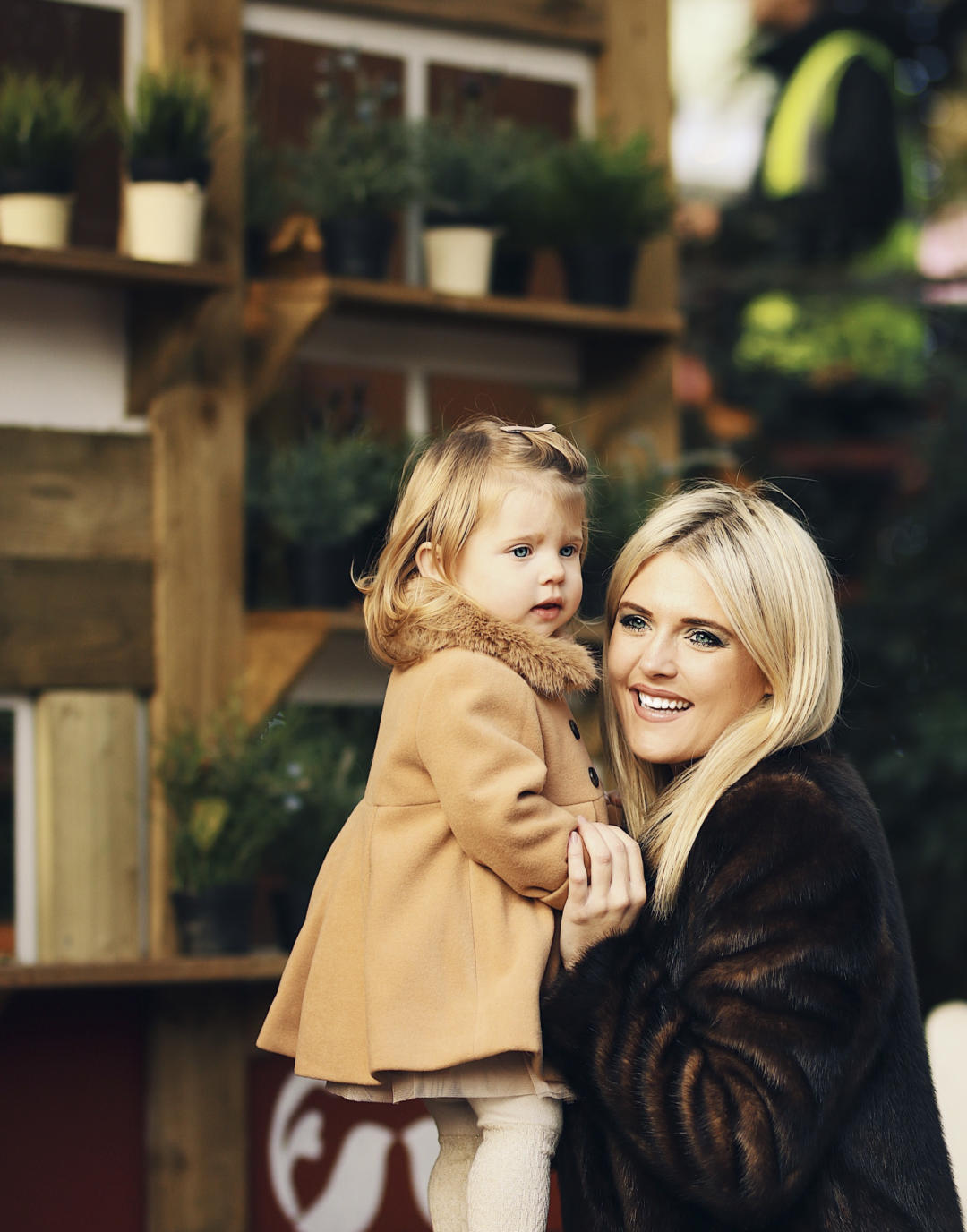 Mother and daughter in warm winter coats from monsoon
