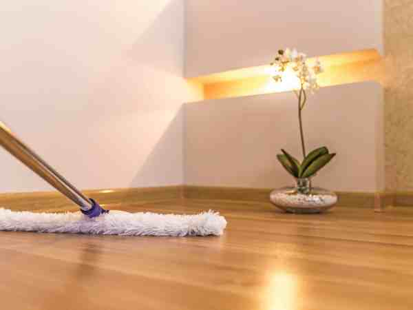 43024210 – modern white mop cleaning wooden floor in house