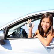 17 year old woman smiling showing new car keys