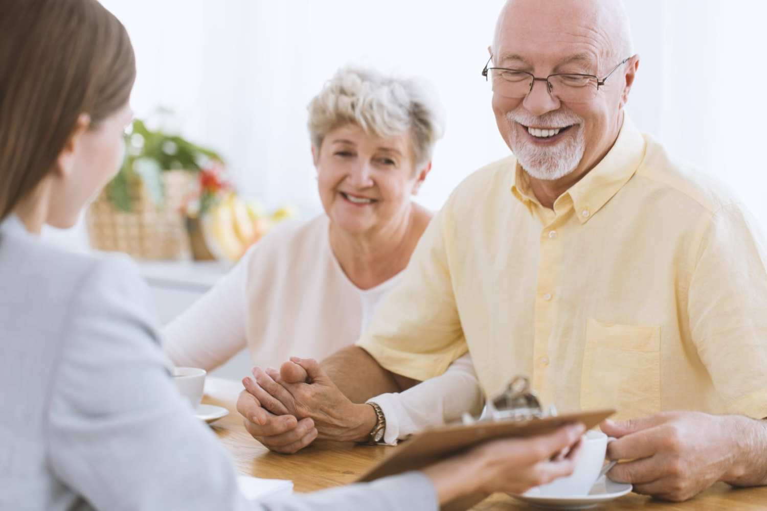 Senior people talking to a financial advisor about life insurance
