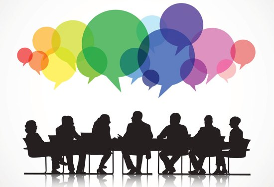 Image of people sitting at a table discussing ideas