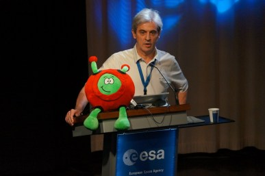 ESA astronaut Leopold Eyhards giving his speech, with Paxi, the ESA Kids Mascot.