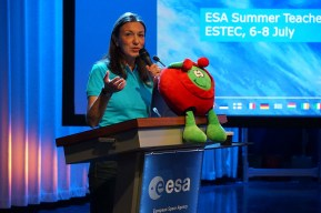 Monica Talevi, head of the STEM unit for ESA Education, giving a speech. Featuring Paxi!