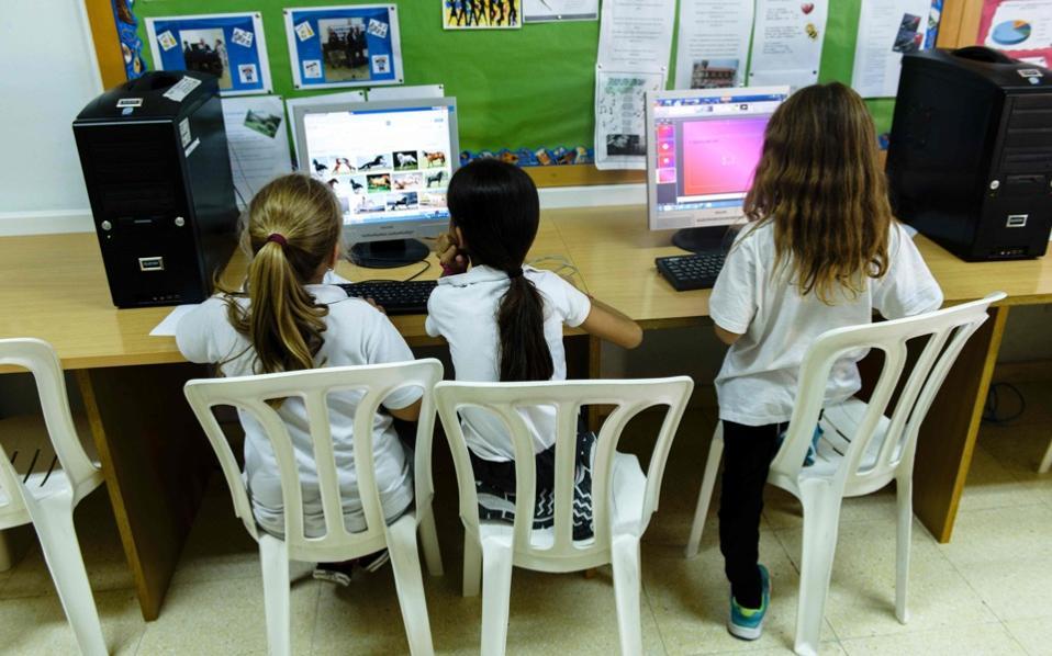 School pupils attend an Aramaic language course in Nicosia.