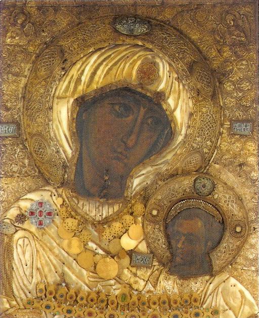 Απεικονίζεται η είκονα της Παναγίας της Πορταϊτισσας και στην αγκαλιά της έχει τον Ιησού