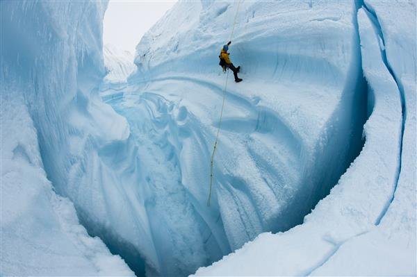 Adam LeWinter ice climbing in Survey Canyon, Greenland