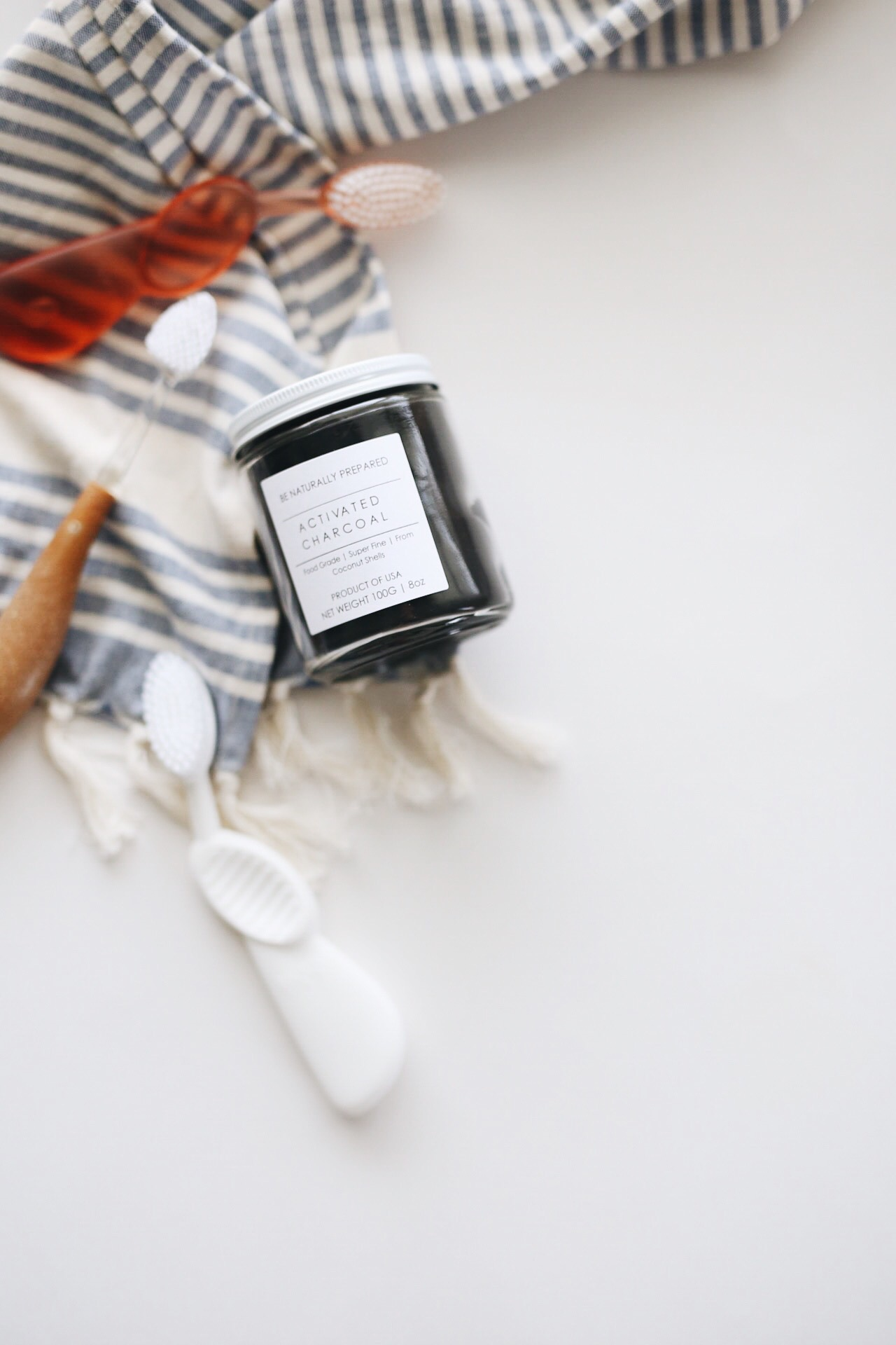 whitening your teeth with activated charcoal | elanaloo.com