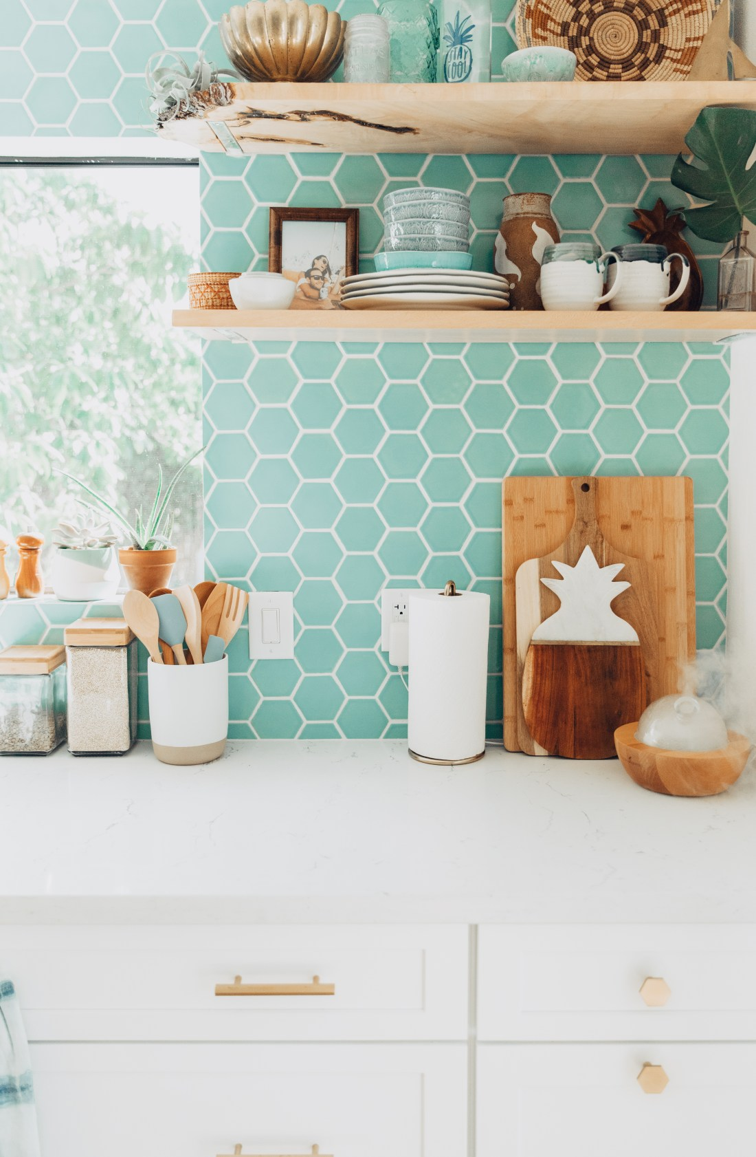 Open Shelving Inspiration | Kitchen Inspo | Kitchen Renovation Reveal | Tropical, Modern, Bohemian Kitchen | Aqua Blue Hexagon Tile Backsplash | Unique Kitchen | Tropical Kitchen | Hawaiian Home Renovation Reveal | White Cabinets with Brass Hardware | Hexagon Brass Cabinet Pulls | Eclectic Kitchen Style | Shibori Towels | Open Shelving via @elanaloo + elanaloo.com
