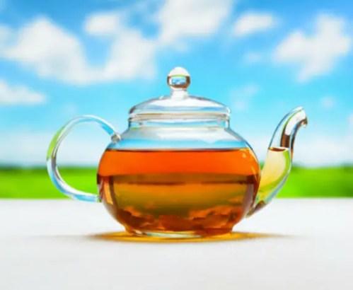 Depositphotos 39398823 xs - Teapot of fresh tea on natural background.