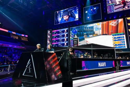 esports - MOSCOW, RUSSIA - 14th SEPTEMBER 2019: esports Counter-Strike: Global Offensive event. Commentators or casters at their place and big screen with game moments behind them.