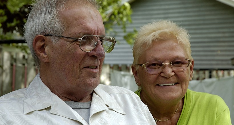 Older couple sitting together dealing with dementia