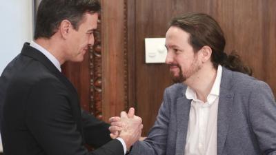 Pedro Sánchez y Pablo Iglesias antes de presentar su acuerdo de Gobierno.