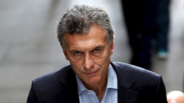 Mauricio Macri, Buenos Aires' City Mayor and presidential candidate for the Cambiemos (Let's Change) front, arrives for a ceremony in Buenos Aires, October 28, 2015. Mauricio Macri, Argentina's opposition challenger in next month's presidential run-off vote, said on Tuesday he wanted to find common ground with defeated candidate Sergio Massa and that talks had begun between the two camps. Massa placed third in Sunday's first round vote with 21.3 percent of support, and both Macri and ruling party candidate Daniel Scioli will need to court the 43-year-old lawmaker and his voters to win the November 22 second round. REUTERS/Marcos Brindicci