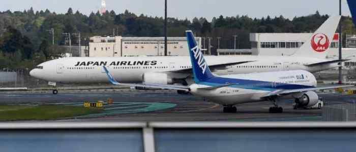 راكب أمريكي يتبول علي ياباني خلال رحلة جوية