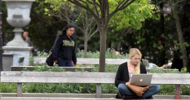 A UC Berkeley student works on her laptop while sitting on the UC Berkeley campus April 23, 2012 in Berkeley, California.