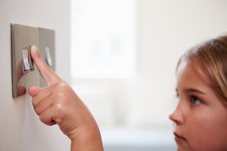 girl flicking light switch
