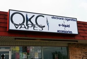 Cabinet wall sign for OKC Vapes.