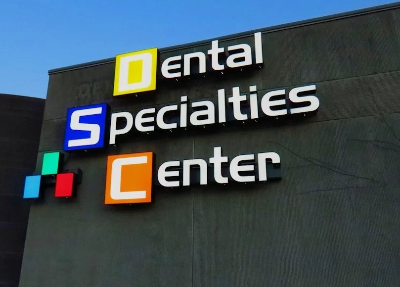 Custom Logo and Wall Sign Fills Dental Center Cavity!