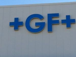 Picture of blue channel letters of +GF+ on the side of a building.