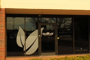 Electremedia provides vinyl graphics and window tinting for New Leaf Wellness.