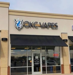 Picture of exterior sign for OKC Vapes in Del City.