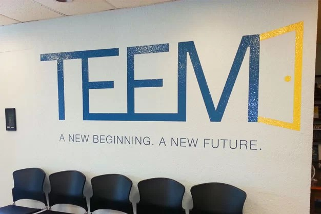Picture of large vinyl graphic on interior wall that says TEEM.