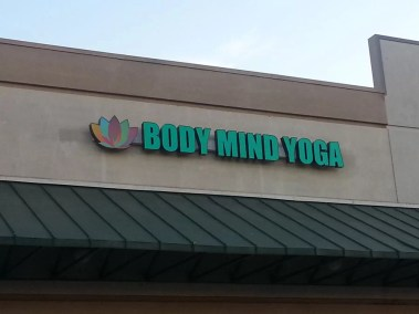 Body Mind Yoga sign before  having power.
