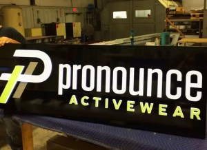 Push-thru acrylic face cabinet sign for Pronounce Activewear.