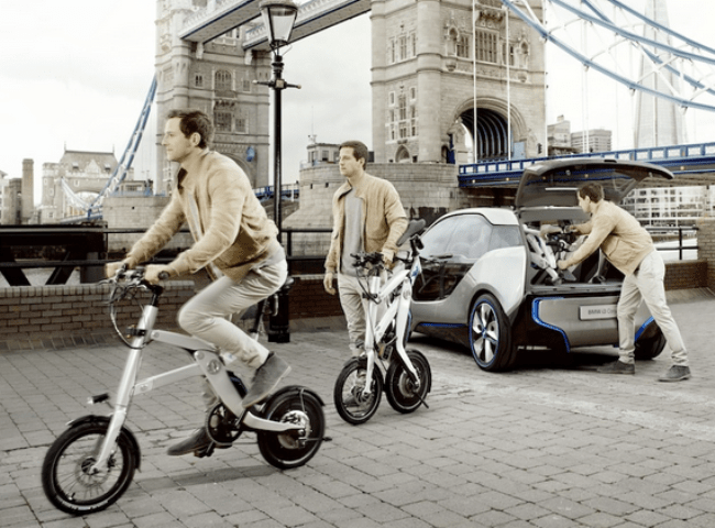 The BMW i-Pedelc folding E-bike, and the i3 electric concept car.