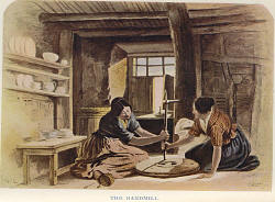 Women turning a hand mill