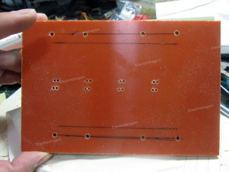 enlarge the holes for PCB test pins with 1.7 mm bit, and also drill the installation holes for locker with same bit, in this pic, the installation holes of locker is already enlarged by 3.0mm bit