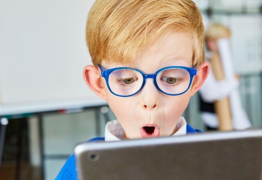 surprised boy at laptop