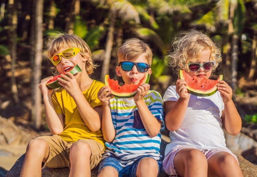 children eating watermelon in summer