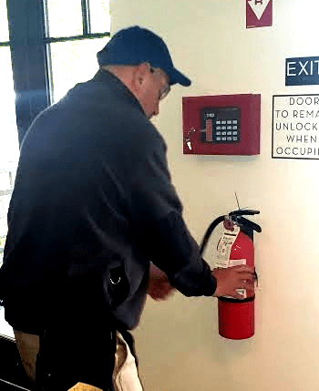 An ESC fire extinguisher technician at work (image)