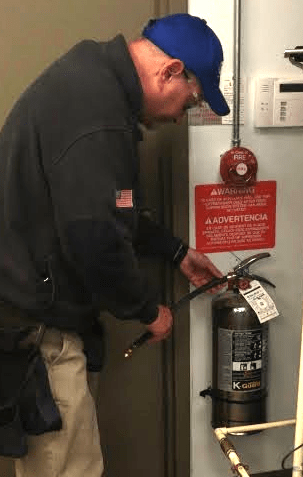 ESC tech working on a fire extinguisher (image)