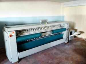 %Folding Machine Electrolux FFS 4831, with ironer, feeder, folding and stacker