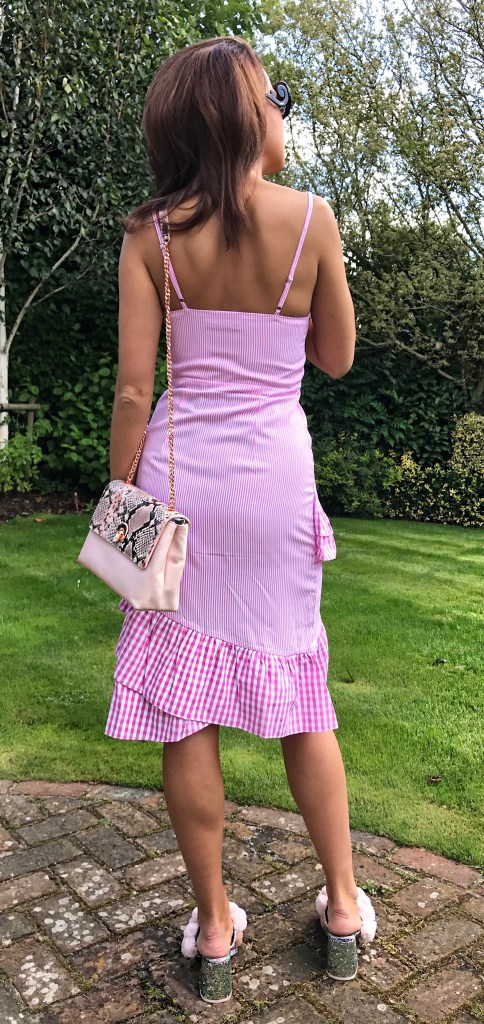 The Ruffle Silhouette that Looks Good on Everyone, ruffle and pink stripes dress, pom pom sandals