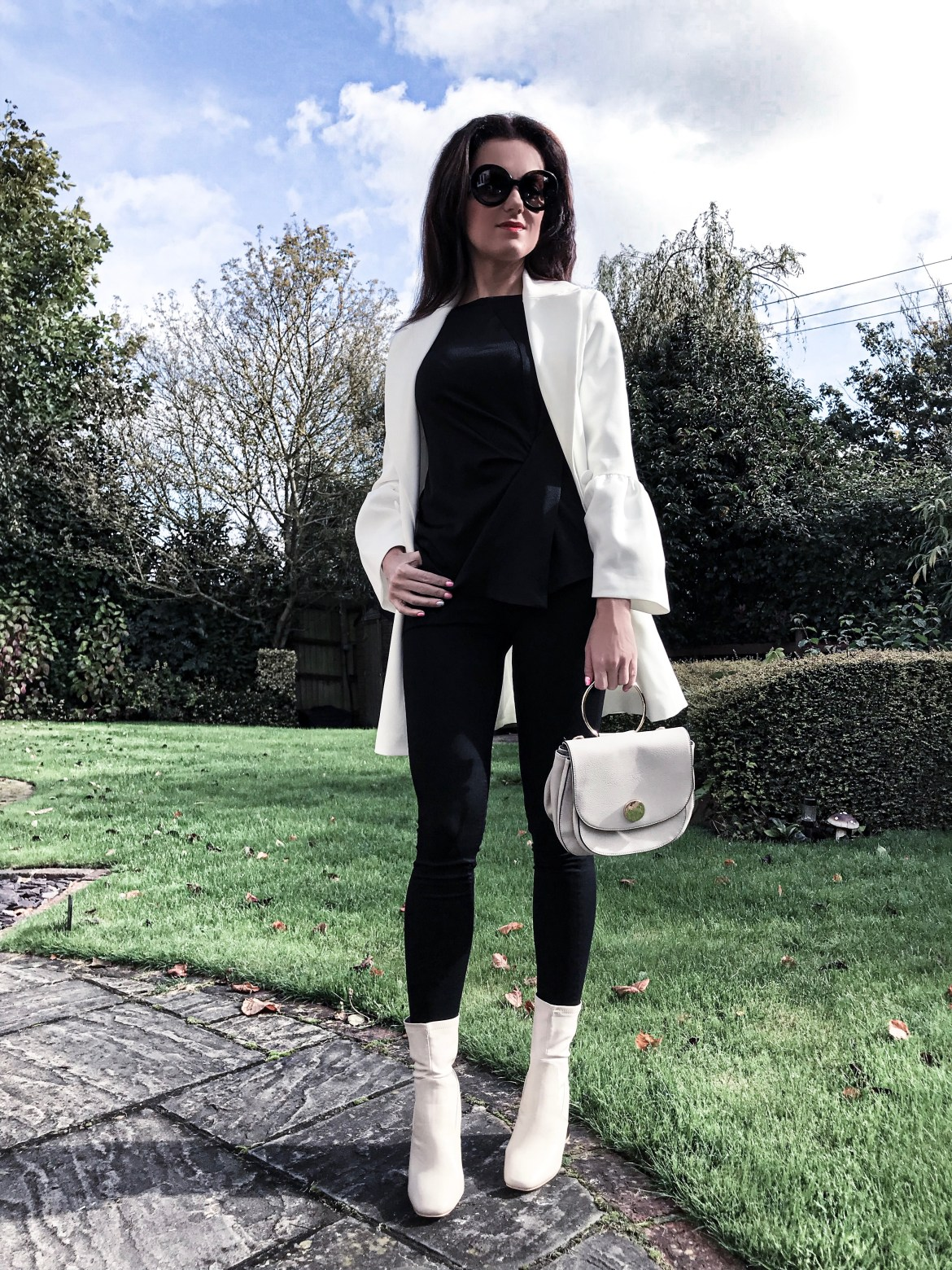 Michelle Keegan Fluted Sleeve Double Breasted Blazer | Lost Ink Bubble Heel Sock Ankle Boot - Cream | Next White Circle Detail Saddle Bag | Prada Baroque sunglasses | Zara top