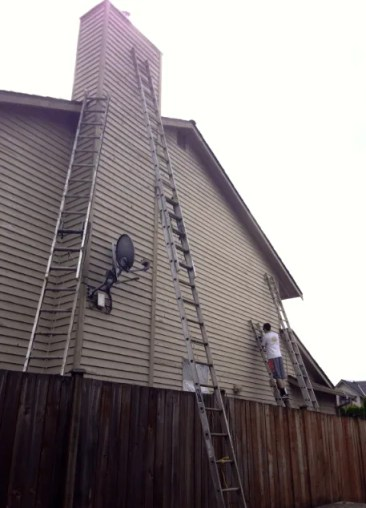 removing loose paint from siding