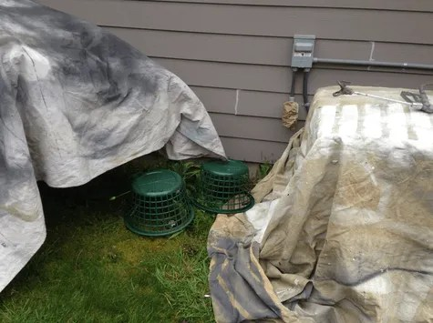dovering ac unit for over spray