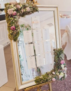 Elegant mirrored seating chart dripping with greenery and flowers wedding mirror ideas also most popular for your day rh elegantweddinginvites