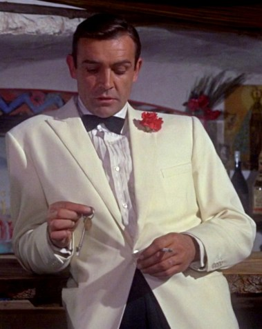 Sean Connery in Goldfinger - white tuxedo with peak lapels and red carnation in the lapel.