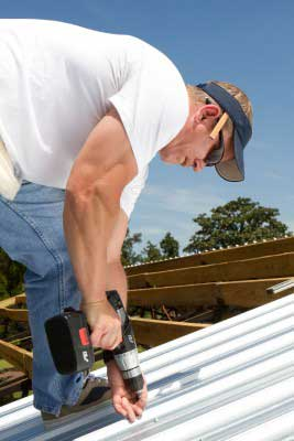 An orinda, ca roofer drills a new roof