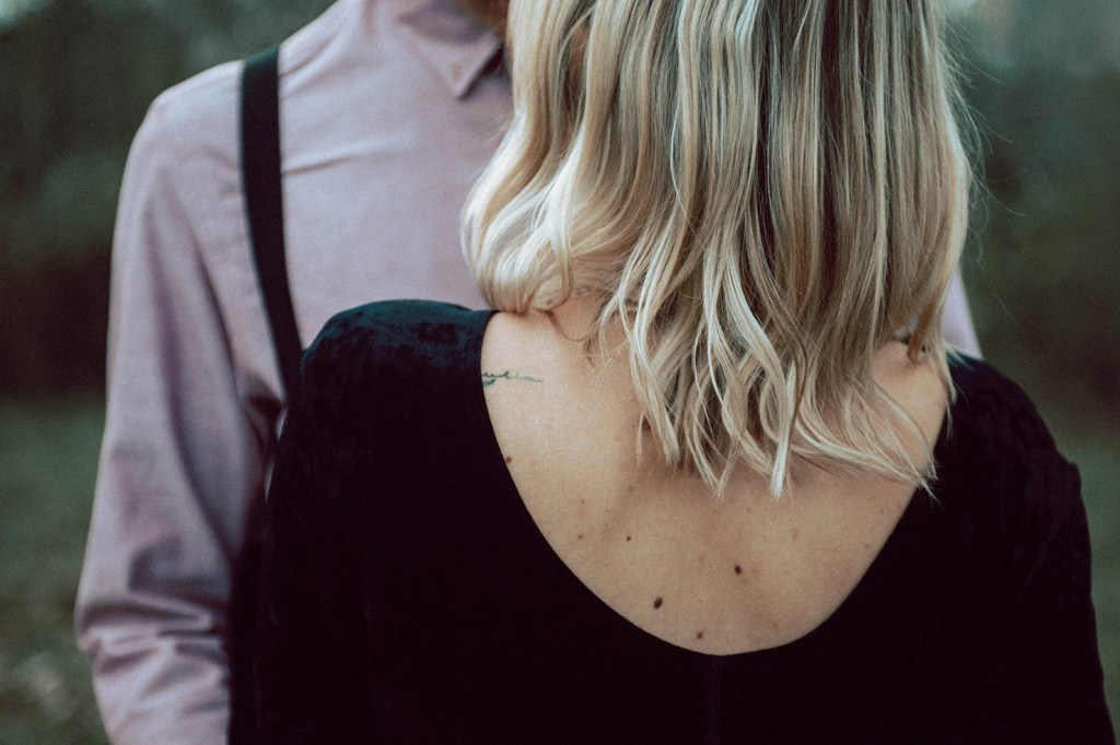Tuscany Engagement Session - detail, back tattoo; couple hugging
