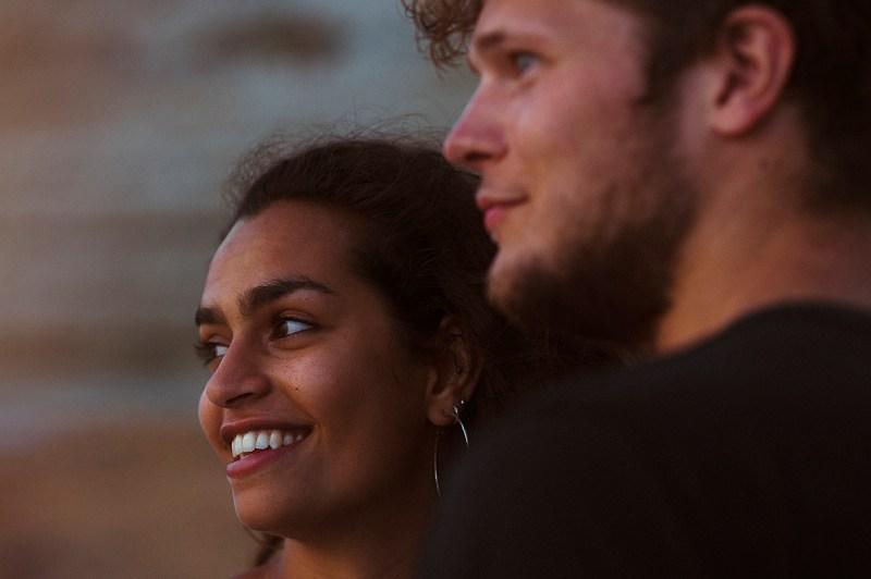 Greece Destination Engagement - Corfu - couple portrait staring at the sunset